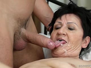 Granny Anastasia tastes his sperm after he fucks their way hard